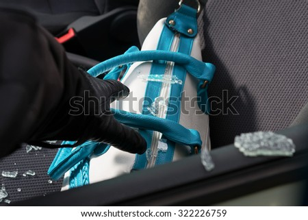 Valuable personal things left on the front seat are easy catch for the thieves. - stock photo