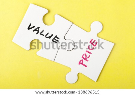 Value and price words written on two pieces of jigsaw puzzle - stock photo