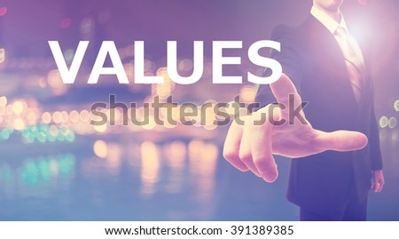 Values concept with businessman on blurred city background  