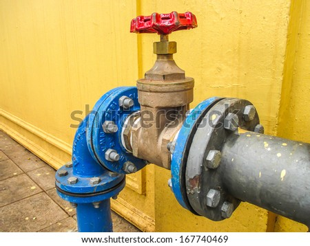 valve connects to water supply with metal pipe. - stock photo
