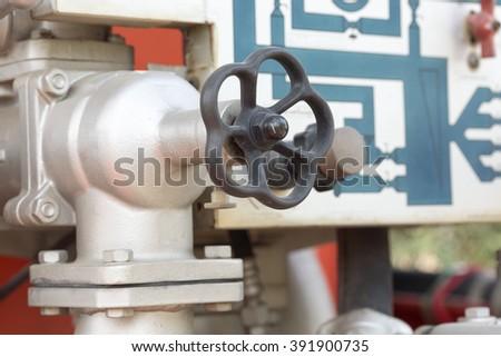 Valve control on firetruck - stock photo