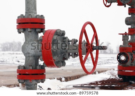 Valve on production wellhead - stock photo
