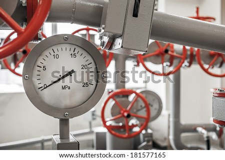 Valves and manometers on Industrial pipeline system - stock photo