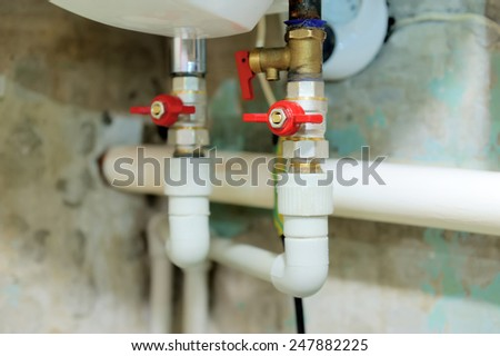 Valves blocking access to water pipes - stock photo