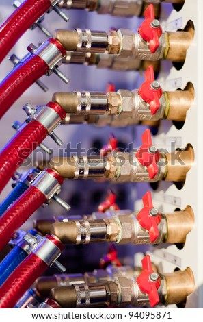 Valves set connected with red pipes - stock photo