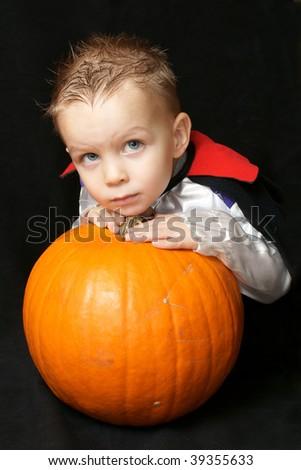 vampire and pumpkin - stock photo