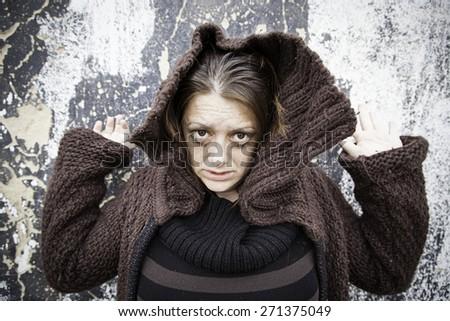 Vampire and sad girl on city street - stock photo