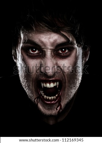 Vampire halloween man. Portrait of blood thirsty vampire man with blood dripping fangs - closeup. - stock photo