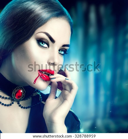 Vampire Halloween  Woman portrait. Beauty Sexy Vampire Girl with blood on her mouth looking at camera. Fashion Art design. Attractive model girl in Halloween costume and make up  - stock photo