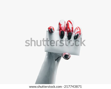 Vampire hand holds empty card on white background, space for text. Halloween/horror theme - stock photo