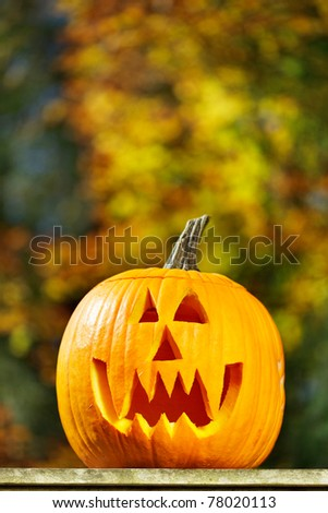 Vampire jack-o-lantern outside on a fall afternoon - stock photo