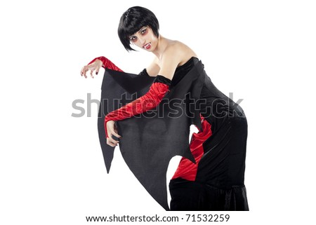 Vampire woman in a bizarre position. Isolated on pure white background.