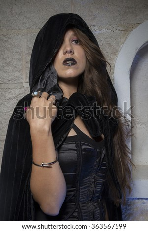 vampire, young beautiful gothic girl with black lace dress and dark black cape