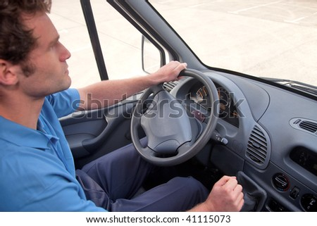 Van driver in a left hand drive vehicle.  Also available as RHD, instrument panel is correct for both images. - stock photo