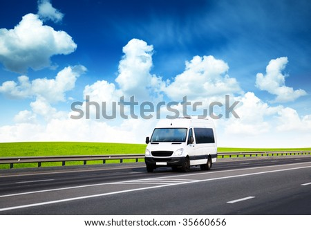 van on road and perfect summer day - stock photo