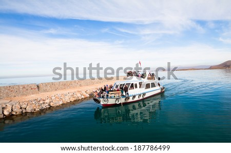 Van, Turkey, November 24, 2012: This is a little ship that carrying a group of women and returning from Akdamar island. - stock photo