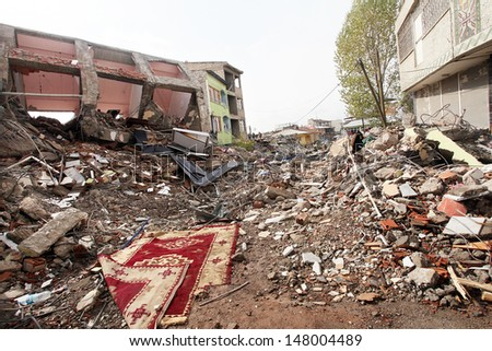 VAN, TURKEY - OCTOBER 25: A building ruined during the earthquake of Van-Ercis on October 25, 2011 in Van, Turkey. It is 604 killed and 4152 injured in Van-Ercis Earthquake.