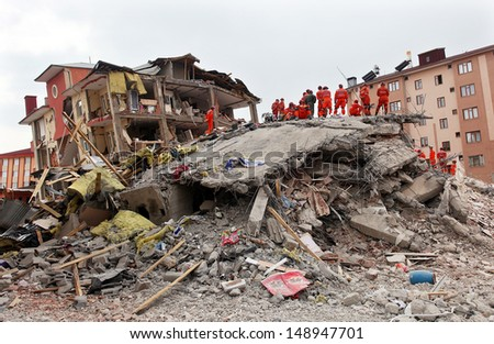 VAN, TURKEY - OCTOBER 25: Rescue team is searching for the wounded under the debris aftter the earthquake on October 25, 2011 in Van, Turkey. It is 604 killed and 4152 injured in Van Earthquake. - stock photo