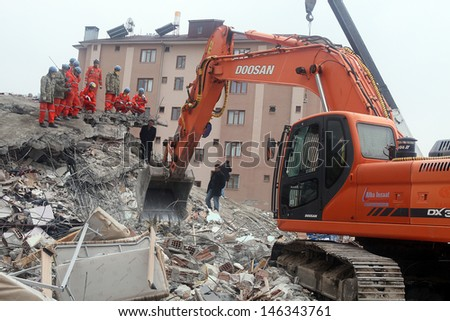 VAN, TURKEY - OCTOBER 25: Rescue team searching for the wounded under the debris after the earthquake on October 25, 2011 in Van, Turkey. It is 604 killed and 4152 injured in Van Earthquake.