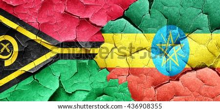 Vanatu flag with Ethiopia flag on a grunge cracked wall - stock photo