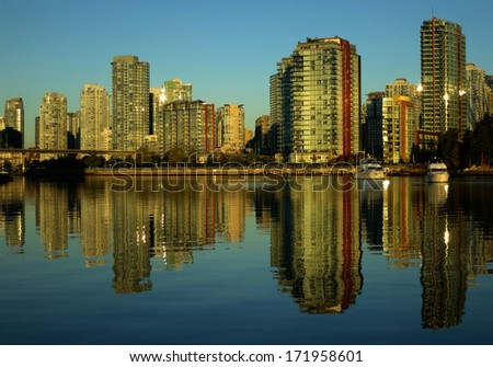 Vancouver at sunset as seen from Stanley Park, British Columbia, Canada - stock photo