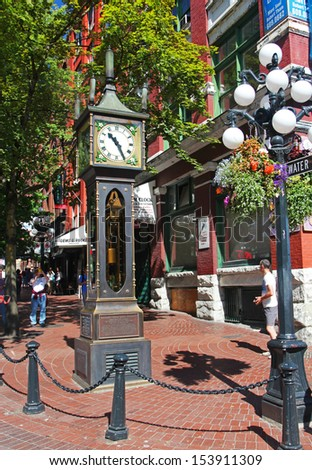 VANCOUVER - AUGUST 8: The Gastown steam clock in Vancouver, Canada on August 8, 2013. Vancouver has been ranked the third most liveable city in the world for the second year in a row. - stock photo