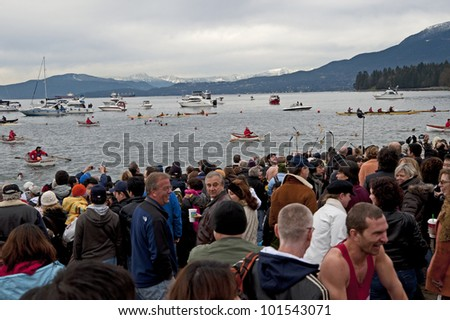 VANCOUVER, B.C - JANUARY 1, 2008: Polar Beer Swimming is provided by Vancouver's West End at scenic English Bay beach every New Years day. January 1, 2008 in British Columbia, Canada