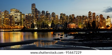 Vancouver BC Canada City Skyline and Deadman's Island at Night Panorama - stock photo