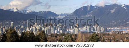 Vancouver BC Canada City Skyline and Snow Capped Mountains Panorama - stock photo