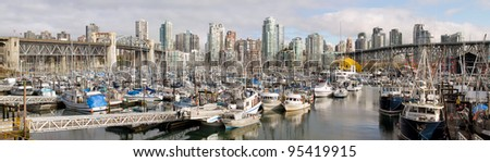 Vancouver BC Canada City Skyline with Burrard and Granville Bridges from Granville Island Panorama - stock photo