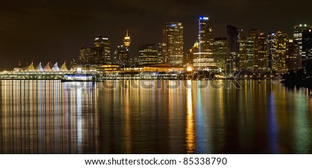 Vancouver BC Canada Downtown Skyline from Stanley Park at Night - stock photo