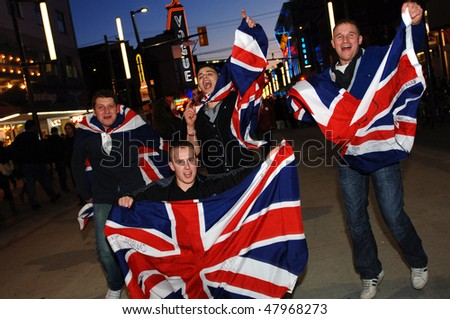 VANCOUVER, BC, CANADA - FEBRUARY 21: British fans celebrate England Curling Team win over USA Curling Team during 2010 Winter Games, February 21, 2010 in Vancouver, BC, Canada