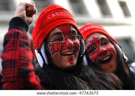 VANCOUVER, BC, CANADA - FEBRUARY 28: Canadian girls celebrate Canada Hockey Team Gold Medal win at 2010 Winter Games, February 28, 2010 in Vancouver, BC, Canada - stock photo