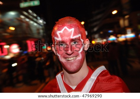 VANCOUVER, BC, CANADA - FEBRUARY 28: Canadian man enjoys festive atmosphere in Vancouver during 2010 Winter Games, February 28, 2010 in Vancouver, BC, Canada - stock photo