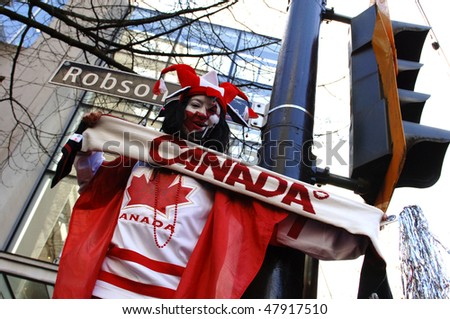 VANCOUVER, BC, CANADA - FEBRUARY 28: Canadian woman celebrates Canada Hockey Team Gold Medal win at 2010 Winter Games, February 28, 2010 in Vancouver, BC, Canada - stock photo