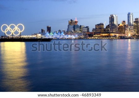 VANCOUVER, BC, CANADA - FEBRUARY 16: Vancouver 2010 Winter Olympic Skyline with inclusion of the Golden Olympic rings on February 16, 2010 at Burrard Inlet, Vancouver, BC.