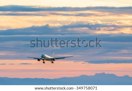 VANCOUVER, BC, CANADA - JULY 27, 2015: An Air Canada A330 on final approach for YVR runway 08L with another aircraft climbing en route in the background.  - stock photo