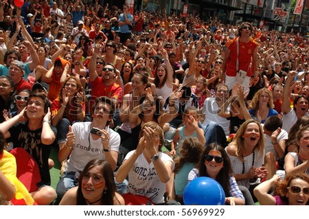 VANCOUVER, BC, CANADA - JULY 11: Spanish fans celebrate Spain soccer team FIFA World Cup final game victory over Dutch soccer team on Granville Street, July 11, 2010 in Vancouver, BC, Canada - stock photo