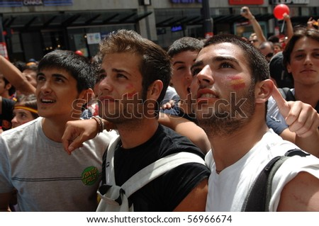 VANCOUVER, BC, CANADA - JULY 11: Spanish fans watch Spain soccer team FIFA Soccer World Cup final game vs Dutch soccer team on Granville Street, July 11, 2010 in Vancouver, BC, Canada - stock photo