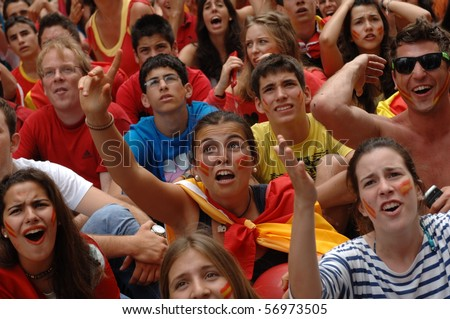 VANCOUVER, BC, CANADA - JULY 11: Spanish fans watch Spain soccer team FIFA World Cup final game vs Dutch soccer team on Granville Street, July 11, 2010 in Vancouver, BC, Canada - stock photo