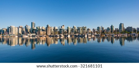 VANCOUVER, BC/CANADA - JULY 30: View of downtown Vancouver city from Stanley Park seawall on July 30, 2015 in Vancouver, Canada.