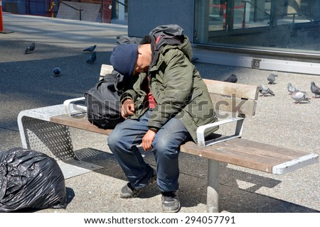VANCOUVER BC CANADA JUNE 12 2015: A total of 1,798 people identified as homeless, with 538 living on the street, 1,136 in shelters and 124 of no fixed address residing in the Metro Vancouver.