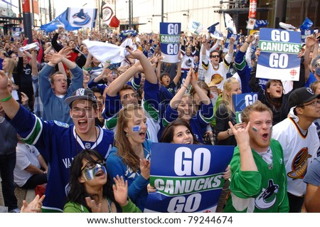 VANCOUVER, BC,CANADA - JUNE 10: Vancouver Canucks fans celebrate Stanley Cup 2011 Finals Game 5 Vancouver Canucks vs. Boston Bruins on June 10, 2011 in Downtown Vancouver, Canada - stock photo