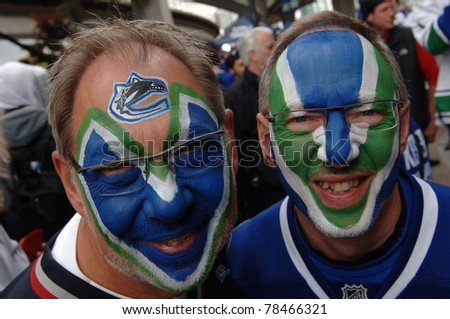 VANCOUVER, BC,CANADA - JUNE 1: Vancouver Canucks fans get ready for Stanley Cup 2011 Final Game 1 vs Boston Bruins on June 1, 2011 in Vancouver, Canada