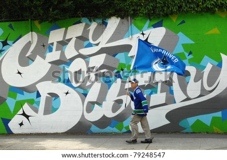 VANCOUVER, BC,CANADA - JUNE 13: Vancouver Canucks fans on streets during Stanley Cup 2011 Series Final Games between Vancouver Canucks and Boston Bruins, on June 13, 2011 in Vancouver, Canada - stock photo