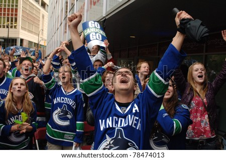 VANCOUVER, BC,CANADA - JUNE 1: Vancouver Canucks fans react to the Stanley Cup 2011 Finals Game 1 win over Boston Bruins on June 1, 2011 in Vancouver, Canada - stock photo