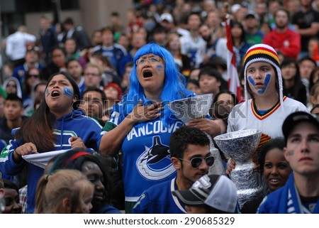 VANCOUVER, BC,CANADA - JUNE 13, 2011: Vancouver Canucks fans watch the Stanley Cup 2011 Finals Game 6 Vancouver Canucks vs. Boston Bruins on June 13, 2011 in Downtown Vancouver, Canada - stock photo