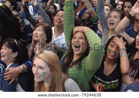 VANCOUVER, BC,CANADA - JUNE 10: Vancouver Canucks fans watch the Stanley Cup 2011 Finals Game 5 Vancouver Canucks vs. Boston Bruins on June 10, 2011 in Downtown Vancouver, Canada - stock photo