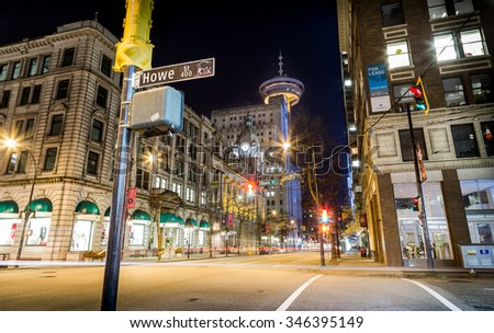 VANCOUVER, BC, CANADA - NOV 27, 2015: Cars passing by the corner of Howe St and Hastings St in downtown Vancouver.