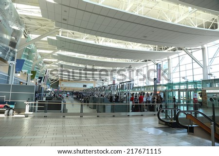 Vancouver, BC Canada - September 13,  2014 : One side of the Vancouver International Airport lobby with blur motion people in Vancouver BC Canada. - stock photo